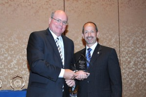 CEO David Bereskin (R)  accepts AMWA Gold Award from AMWA Board President Charles M. Murray (L).