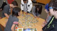 League Academy Students Completing The Water Cycle Puzzle