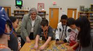League Academy Students Completing The Water Cycle Puzzle with Commissioner Sofield